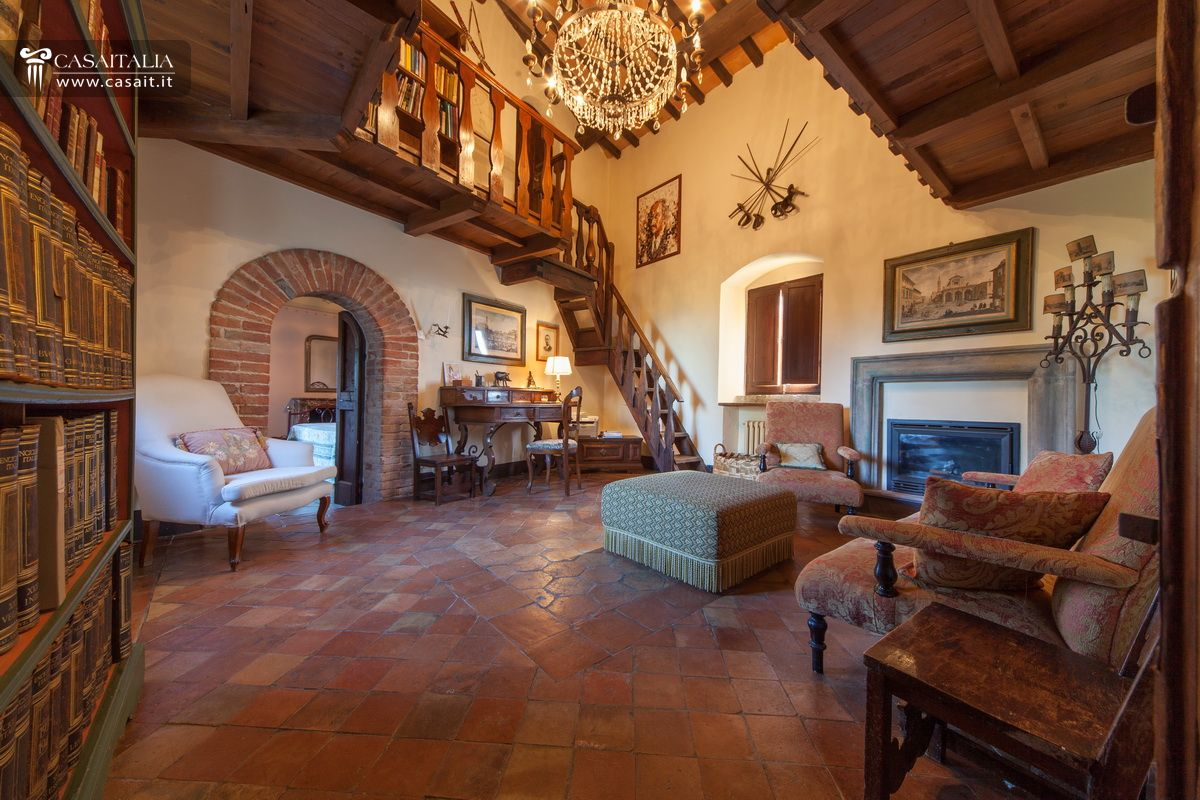 Castles and historical properties for sale in italy for Medieval living room furniture